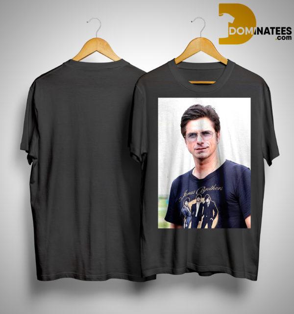 Nick Jonas John Stamos wearing jonas brothers shirt