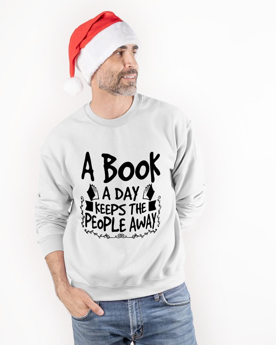 A Book A Day Keeps The People Away Sweater
