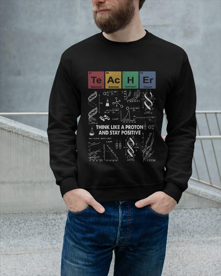 Teacher Think Like A Proton And Stay Positive Sweater